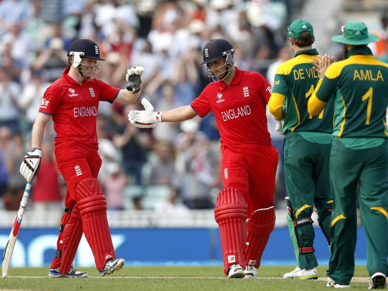 England's Eoin Morgan (L) and Jonathan Trott (C) celebrate their win against South Africa at the end of their ICC Champions Trophy semifinal cricket match at The Oval in London. AP Photo