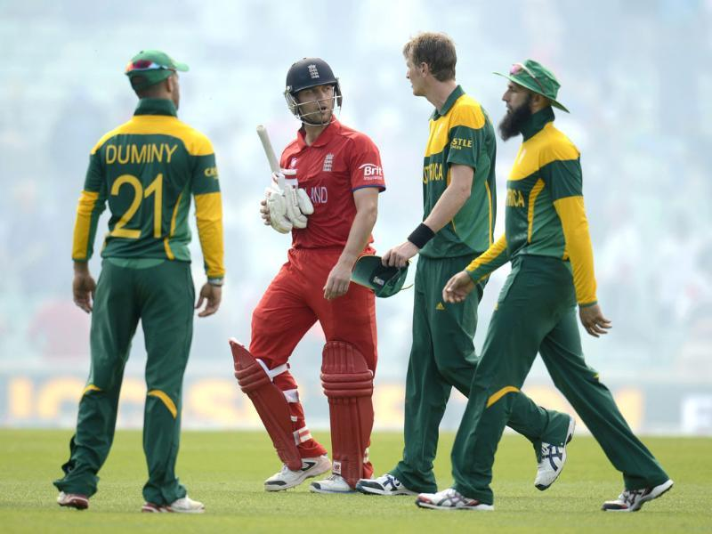 England's Jonathan Trott leaves the field with South Africa's JP Duminy (L), Chris Morris (2nd R) and Hashim Amla (R) after England won the ICC Champions Trophy semi final match at The Oval, London. Reuters