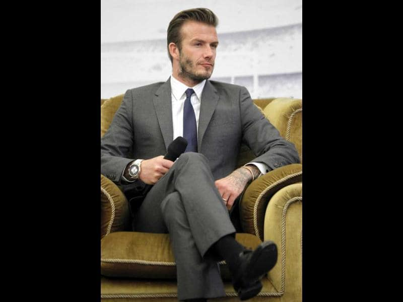Former England soccer captain David Beckham addresses a news conference in Shanghai. (Reuters)