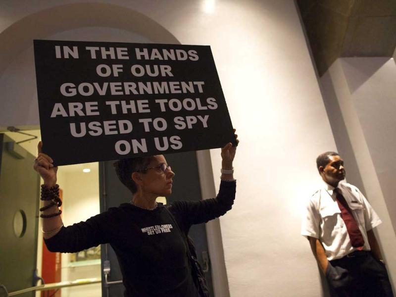 A woman holds up a sign at a support rally for Edward Snowden in New York. (Reuters)