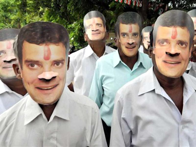 Congress workers wear party vice president Rahul Gandhi's masks to celebrate his 43rd birthday in Coimbatore. (PTI Photo)