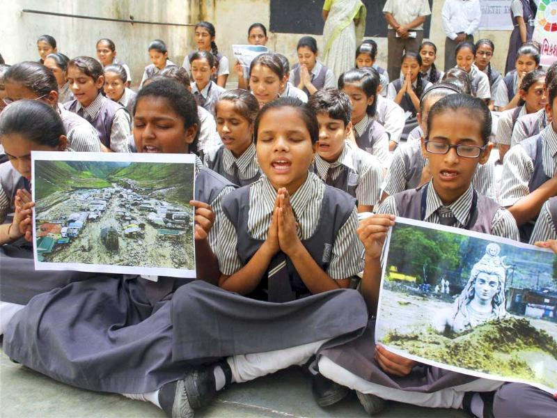 School students pray for the victims of Uttarakhand floods at a school in Ahmedabad. PTI Photo