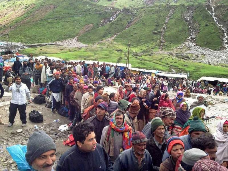 Stranded pilgrims wait for rescue helicopters of Army and IAF near flood-hit Kedarnath shrine in Rudraprayag. PTI Photo