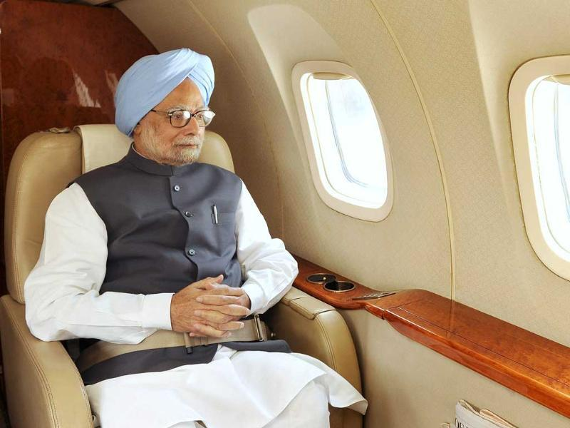 In this photograph received from the Press Information Bureau (PIB), Prime Minister Manmohan Singh is pictured in flight making an aerial survey of disaster affected areas of Uttarakhand. AFP PHOTO