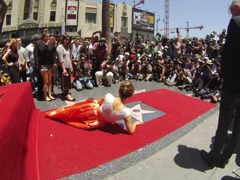 JLo, seen here posing on her star after it was unveiled on the Walk of Fame, said that the landmark moment would inspire her to work harder and dream bigger for the future. (Reuters Photo)