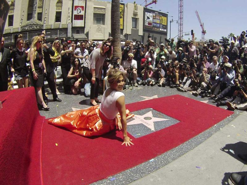 Jennifer Lopez has been honored with the 2,500th star on the Hollywood Walk of Fame, in Hollywood, California (Reuters Photo). Check out the actress pose on her star.
