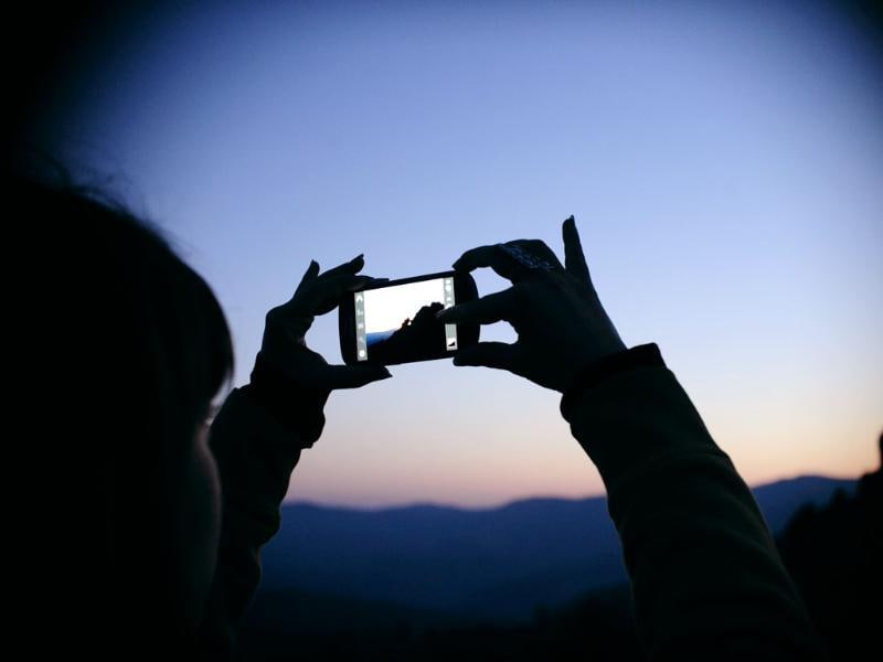 A girl takes photos of the Kokino megalithic observatory during the summer solstice celebration in Kumanovo. Reuters