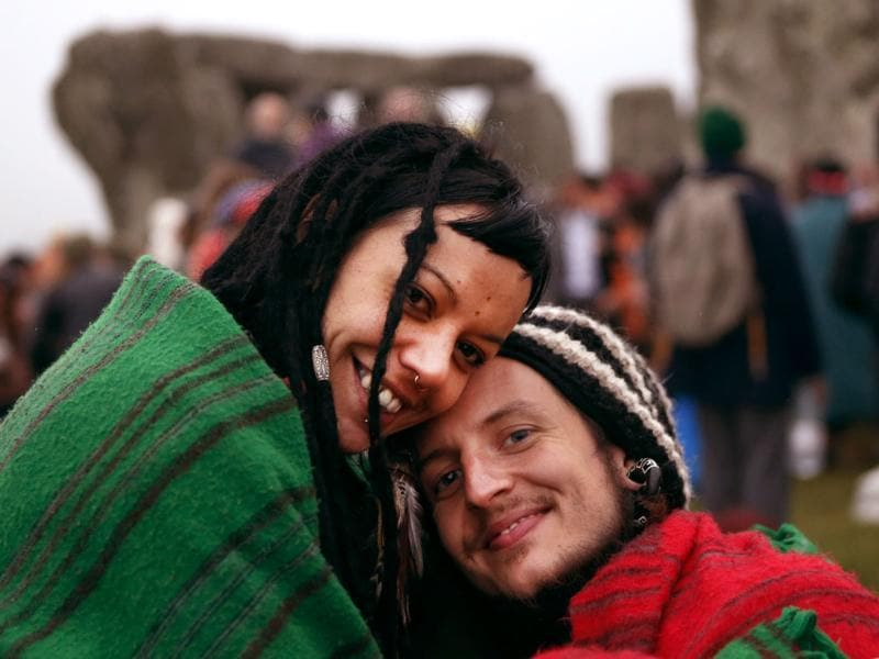 Revelers pose for a photograph during the summer solstice shortly after 04.52 am at the prehistoric Stonehenge monument, near Salisbury, England. AP