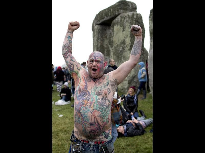 Revelllers celebrate the pagan festival of 'Summer Solstice' at Stonehenge in Wiltshire in southern England. AFP