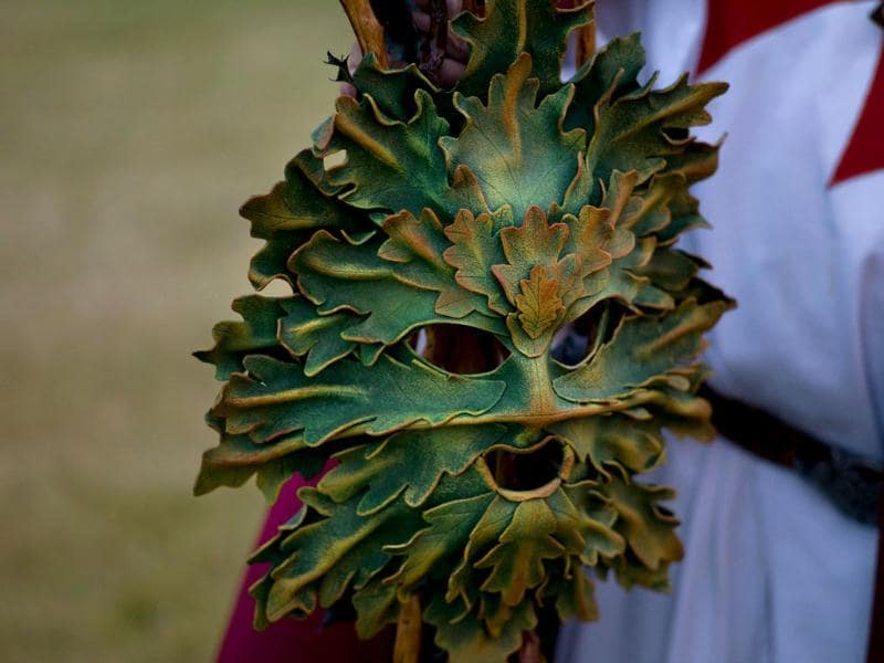 A druid mask is seen on Salisbury Plain in southern England. Stonehenge is a celebrated venue of festivities during the summer solstice and it attracts thousands of revellers, spiritualists and tourists. Reuters