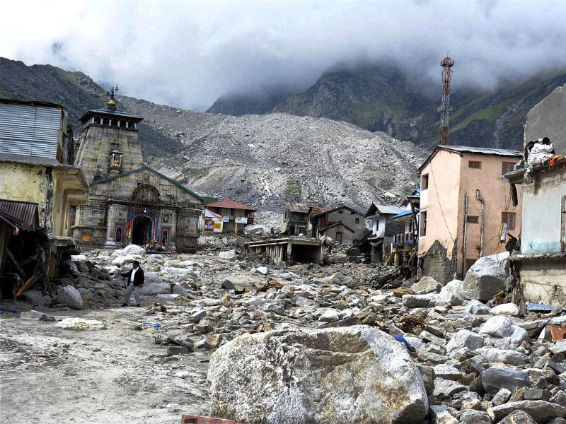 Kedarnath shrine, one of the holiest of Hindu temples dedicated to Lord Shiva, and other buildings are seen damaged on Thursday following heavy rains and flood in Uttarakhand PTI