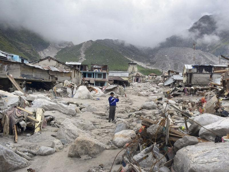 A man snaps pictures in an area devastated following heavy monsoon rains at Kedarnath. (AP file photo)
