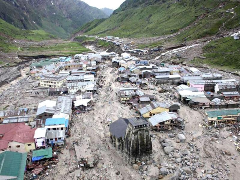 The Kedarnath Temple (C, foreground) is pictured amid flood destruction in Kedarnath, located in Rudraprayag, Uttarakhand. (AFP)