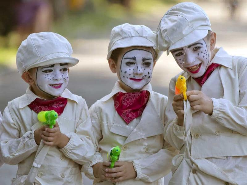 Children wearing vintage outfits prepare to perform during an open air theater show at a park in Bucharest, Romania. (AP)
