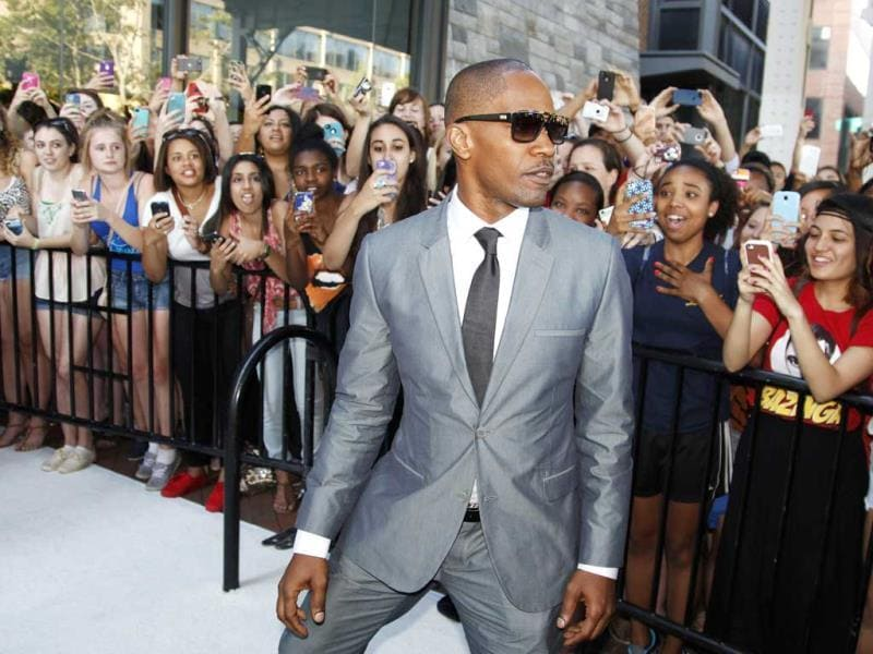 Actor Jamie Foxx greets fans as he arrives for the premiere of his new action film