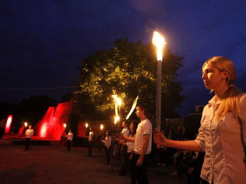 People with torches take part in a ceremony at the Hero fortress in the western city of Brest, some 360 km (223 miles) southeast of Minsk. Belarus marks the 72nd anniversary of the Nazi Germany invasion on Saturday. (Reuters)