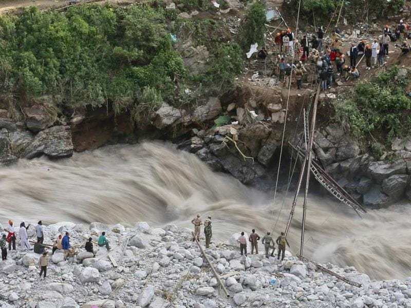 Soldiers try to repair a temporary footbridge over River Alaknanda after it was destroyed, during rescue operations in Govindghat in Uttarakhand. (Reuters)