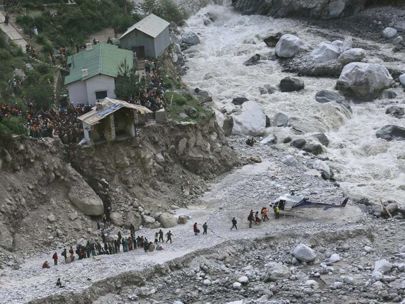 Soldiers assist survivors to board a rescue helicopter next to River Alaknanda, during rescue operations in Govindghat in Uttarakhand. (Reuters)