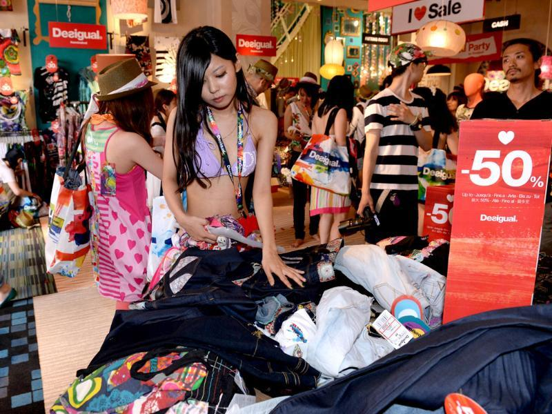 Female shoppers in swimwears choose their clothes during the