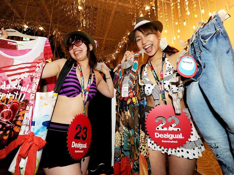 Erika (L) and Miho (R) show off their selected clothes during the