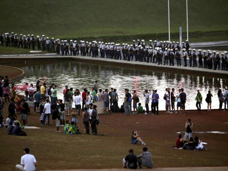 Police guard Congress as a reduced number of anti-government demonstrators appear for a protest that was postponed at the last minute for next week, in Brasilia. (Reuters)