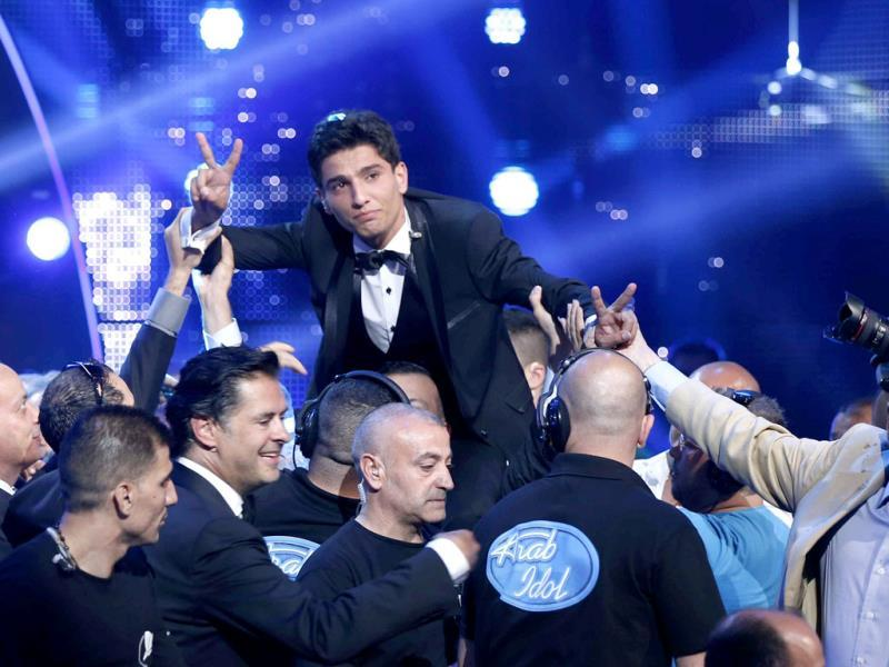 Palestinian singer Mohammed Assaf reacts after being announced winner of the Season 2 finale of