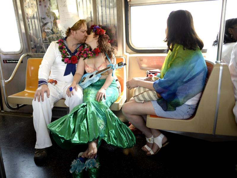 Parade participants ride the subway in costume for the 31st Annual Mermaid Parade at New York's Coney Island. Over 700,00 people are exptected to turn out for the scantily clad parade. (AFP)