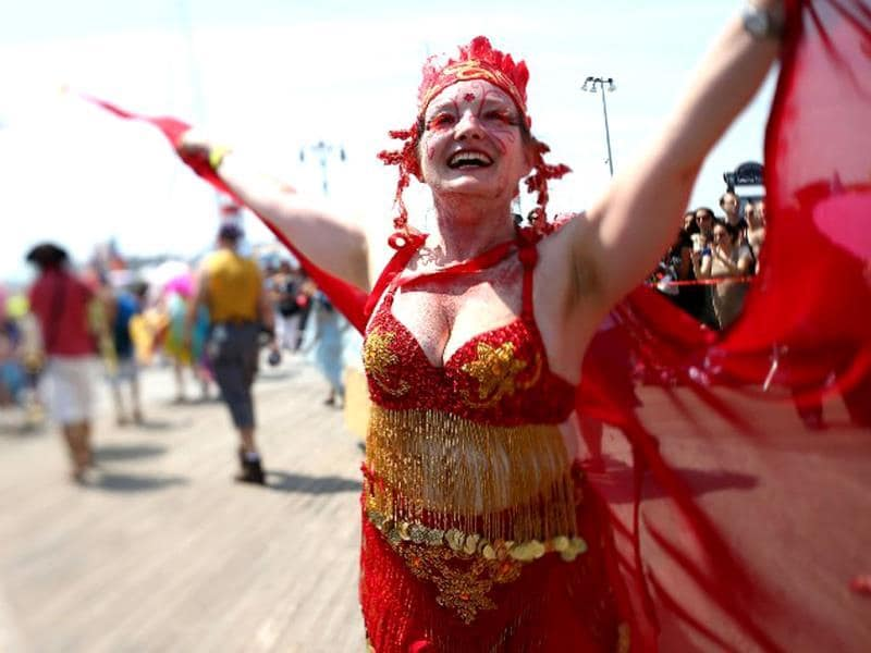 A reveler marches during the 2013 Mermaid Parade at Coney Island in the Brooklyn borough of New York City. (AFP)
