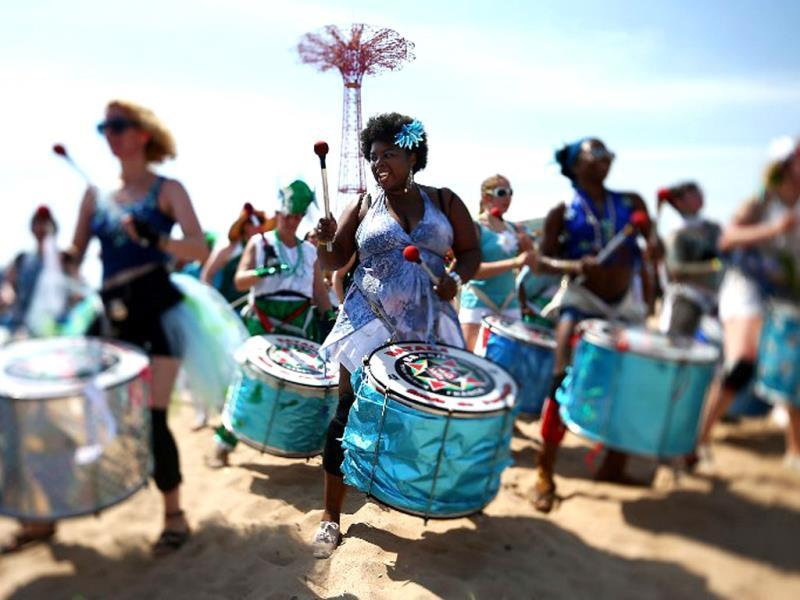 Musicians from Batala NYC perform on the beach at the 2013 Mermaid Parade at Coney Island in the Brooklyn borough of New York City. (AFP)