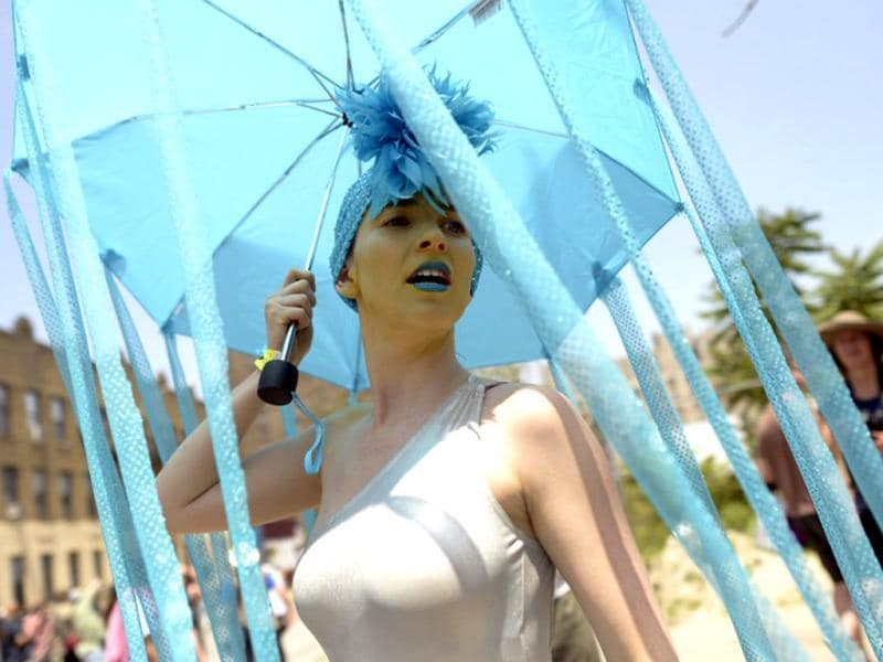 A parade participant arrives in costume for the 31st Annual Mermaid Parade at New York's Coney Island. Over 700,00 people are exptected to turn out for the scantily clad parade. (AFP)