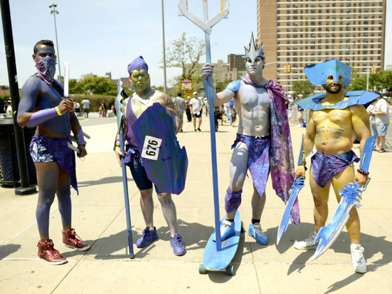 Parade participants arrive in costume for the 31st Annual Mermaid Parade at New York's Coney Island. Over 700,00 people are exptected to turn out for the scantily clad parade. (AFP)