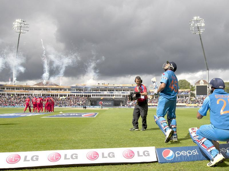 Rohit Sharma and Shikhar Dhawan take to the pitch as play finally begins during their ICC Champions Trophy final match against England at Edgbaston ground, Birmingham, England. AP