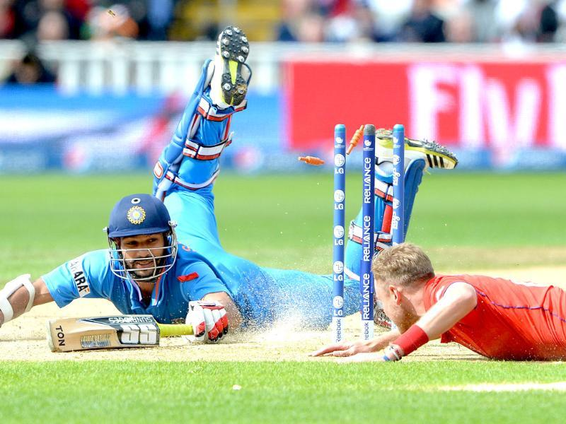 Shikhar Dhawan makes his ground as England's Stuart Broad attempts to run him out during 2013 ICC Champions Trophy final match in Birmingham. AFP
