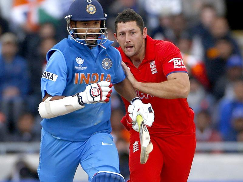 England's Tim Bresnan bumps into Shikhar Dhawan during their ICC Champions Trophy final match in Birmingham. Reuters