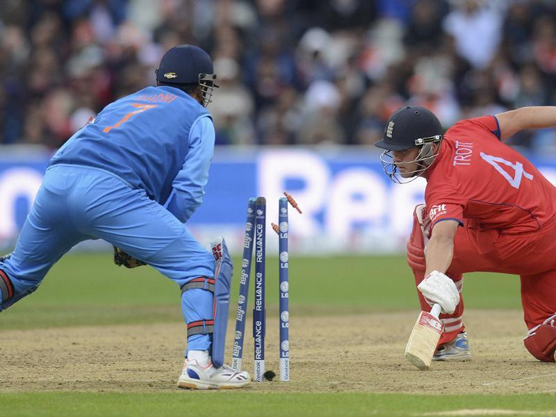 England's Jonathan Trott looks back to see that he is stumped by MS Dhoni during the ICC Champions Trophy final match in Birmingham. Reuters