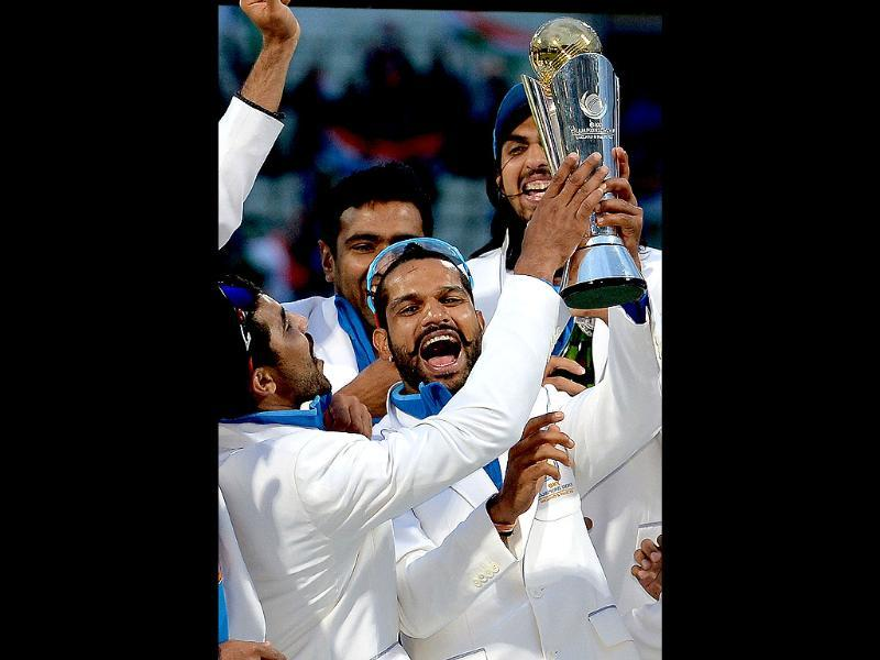 Shikhar Dhawan celebrates with the trophy after India won the 2013 ICC Champions Trophy against England in Birmingham. AFP