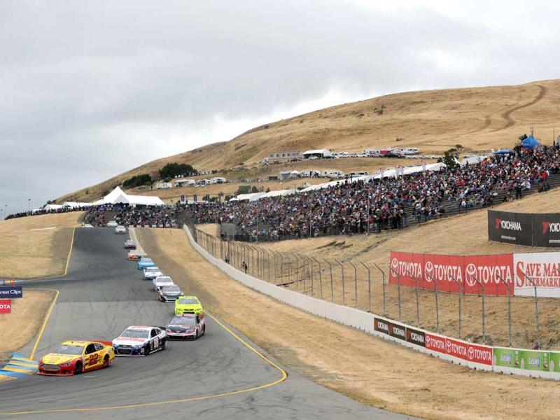 Joey Logano, driver of the #22 Shell-Pennzoil Ford, leads a pack of cars during the NASCAR Sprint Cup Series Toyota/Save Mart 350 at Sonoma Raceway in Sonoma, California. (AFP)