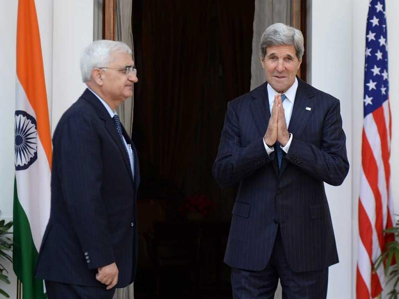 US Secretary of State John Kerry (R) gestures to greet as Indian External Affairs Minister Salman Khurshid (L) looks on prior to a meeting in New Delhi. (AFP)