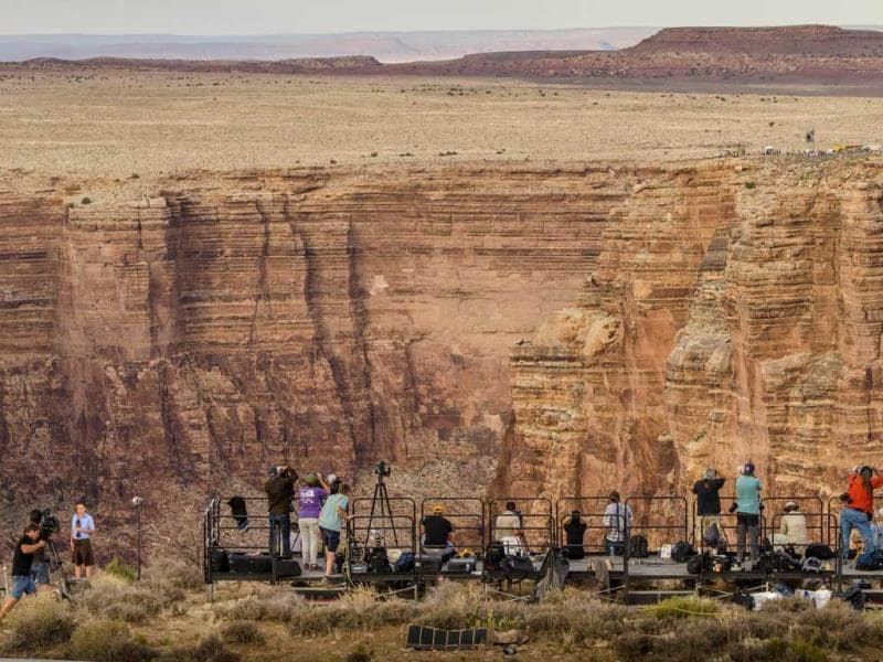 Photographers and TV journalists report on Nik Wallenda daring attempt to walk without any harnesses or any safety precautions on a tightrope stretched across the Little Colorado River Gorge near the Grand Canyon. (AFP)