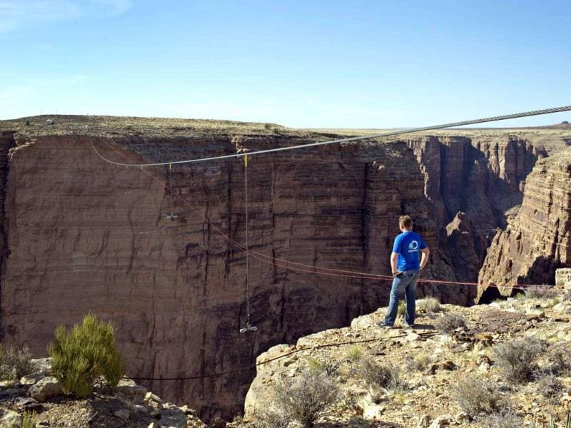 Aerialist Nik Wallenda looks across the canyon before walking a 2-inch-thick steel cable that took him a quarter mile over the Little Colorado River Gorge in northeastern Arizona. (AP)