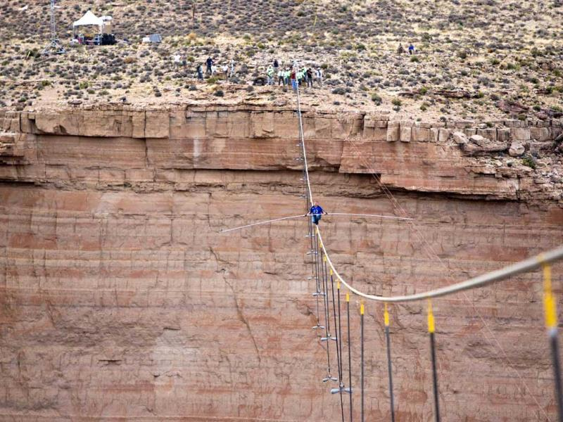 Aerialist Nik Wallenda pauses during his quarter mile walk over the Little Colorado River Gorge in northeastern Arizona. (AP)