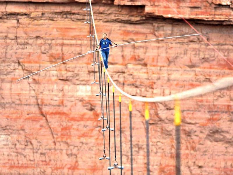 Aerialist Nik Wallenda walks a 2-inch-thick steel cable taking him a quarter mile over the Little Colorado River Gorge, Arizona. (AP/Discovery Channel)