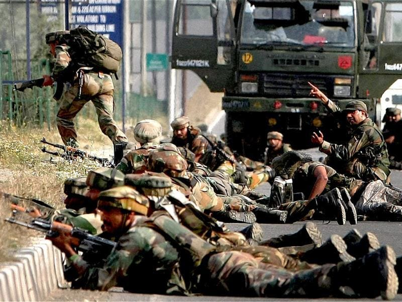 Soldiers take positions during an encounter after militants attacked an Army convoy at Hyderpora in Srinagar on Monday. PTI