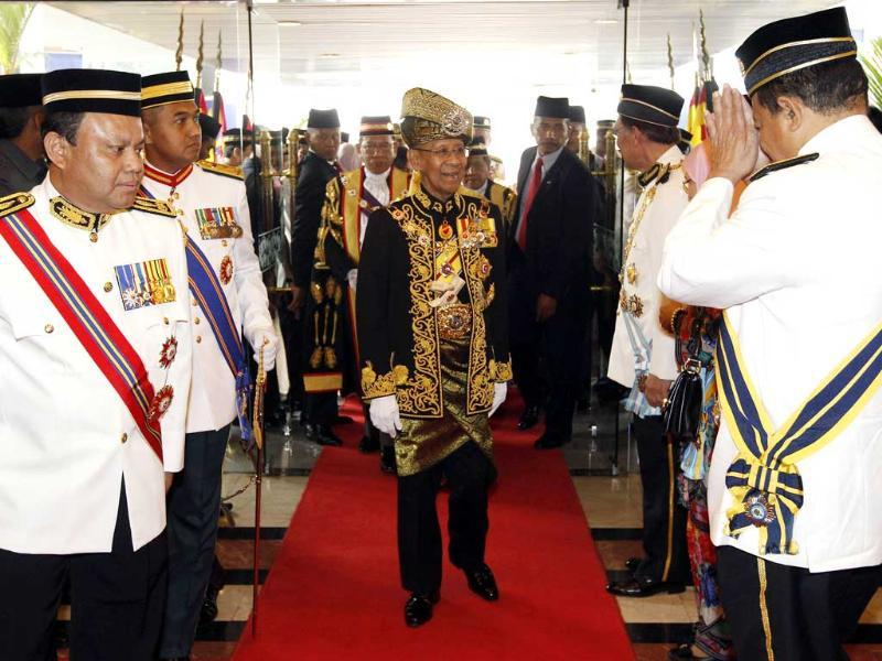 Malaysia's King Abdul Halim Mu'adzam Shah (C) arrives for the opening of the parliament sitting at Parliament House in Kuala Lumpur. Reuters