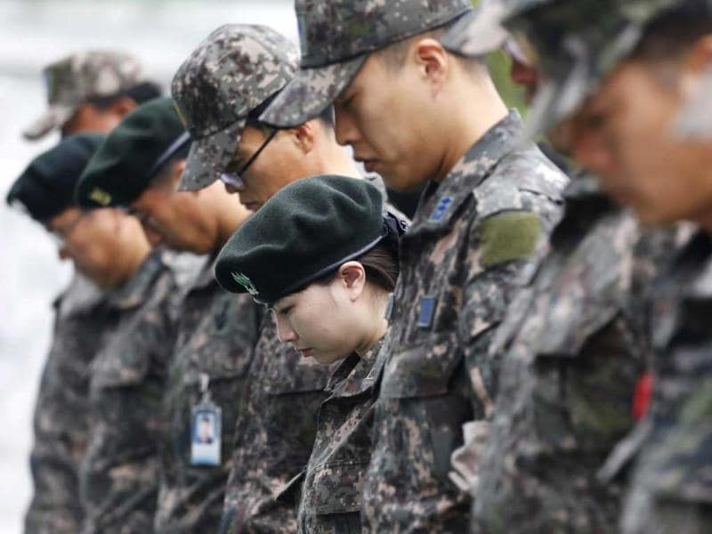 South Korean soldiers pray in silence at the national cemetery in Seoul on the 63rd anniversary of the outbreak of the 1950-53 Korean War. Reuters
