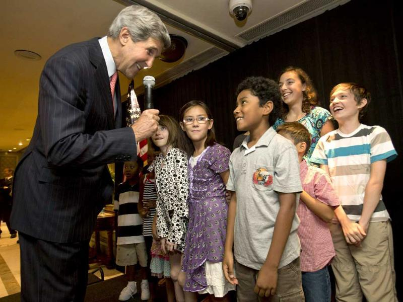 US secretary of state John Kerry (L) greets children during a meet and greet with staff and families from the US embassy in New Delhi. Reuters