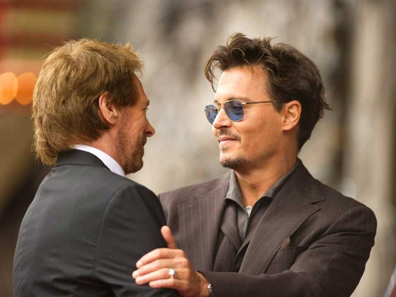 Depp and Bruckheimer in a candid moment
