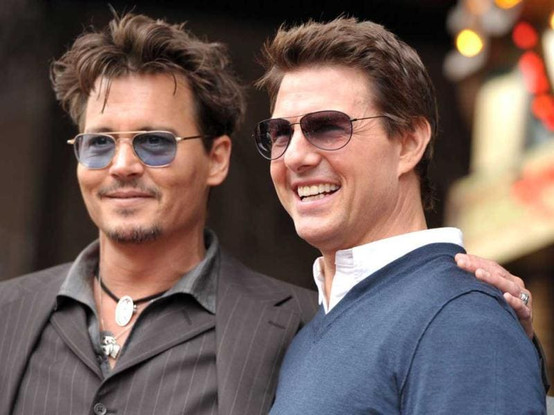 All smiles! Depp and Cruise at Jerry Bruckheimer's Hollywood star event