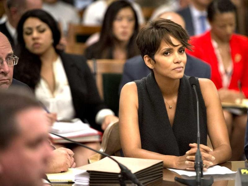 Actress Halle Berry testifies before the Assembly Committee on Public Safety for a bill that would limit the ability of paparazzi to photograph children of celebrities and public figures at the Capitol in Sacramento, California. (AP)