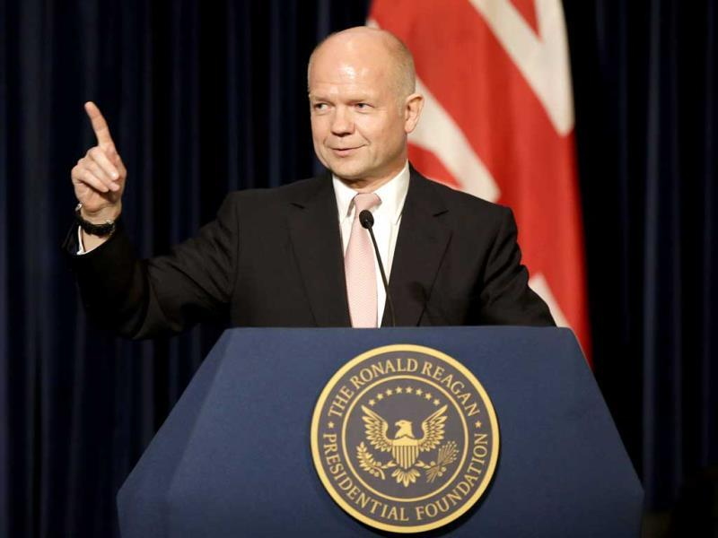 British Foreign Secretary William Hague speaks at the Ronald Reagan Presidential Library. Hague defended his country's intelligence-sharing ties with the United States as governments in both countries face criticism about snooping on citizens. (AP)